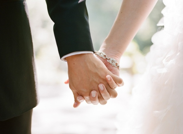 Bride and Groom Holding Hands Wedding Day Paris